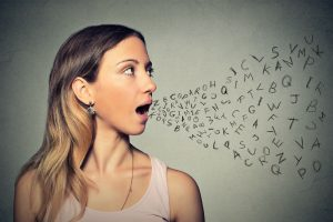 woman with letters coming from her mouth