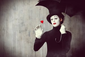 mime standing with umbrella