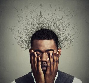 Man's head filling with critical thoughts