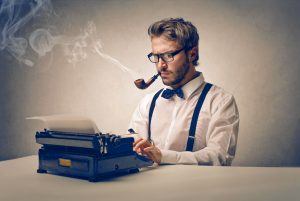 man smoking pipe at typewriter