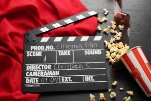 clap board and popcorn