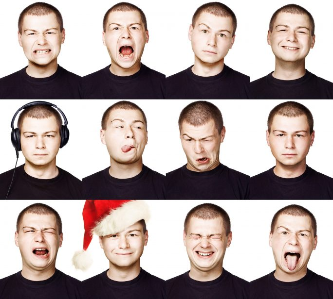man making different faces