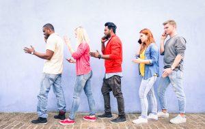 young people on phones walking like robots