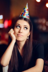 lonely woman in party hat