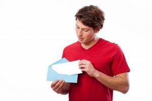 man looking into envelope