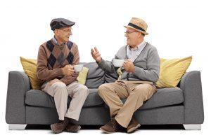 old men talking on a sofa