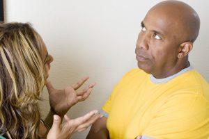 woman explaining to skeptical man