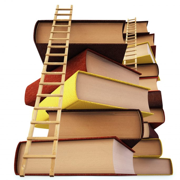 stack of books with ladders to scale them