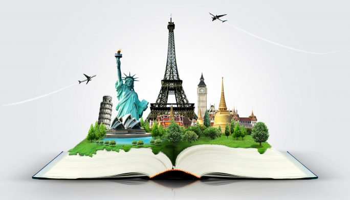 open book with international monuments displayed